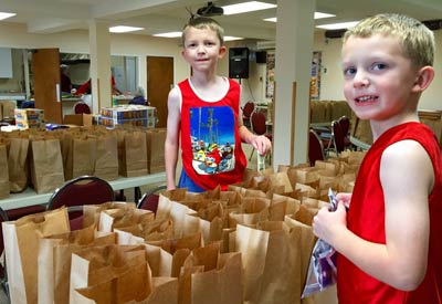 Everyone can help pack hundreds of lunches for the homeless